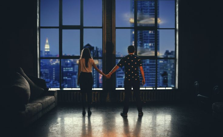 ouple-holding-hands-at-night