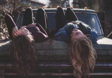 friends-lying-on-car